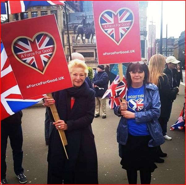 Two of our fantastic activists get ready for the march to pass