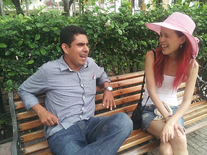Spanish student talks to local man on a bench in Cartagena