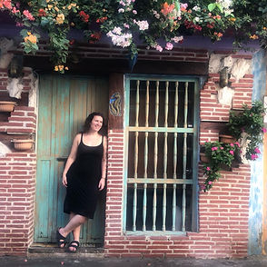 Letra Caribe student poses in a doorway in Cartagena.