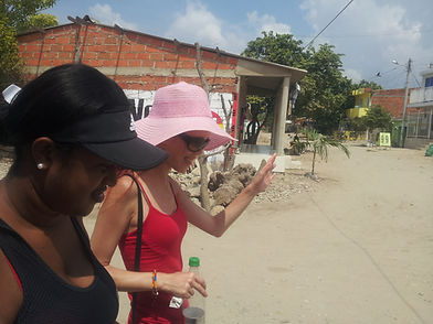 Letra Caribe student talks to a local while walking in a barrio of Cartagena.
