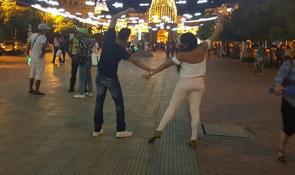 Local couple dancing by the Clock Tower in Cartagena.