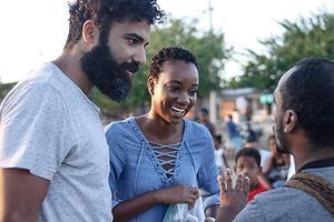 Students of Letra Caribe Language School talk to teacher, Gustavo