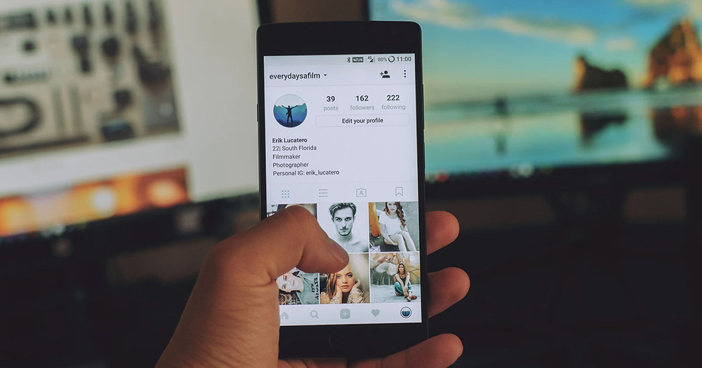 A person holding a smartphone with opened Instagarm account