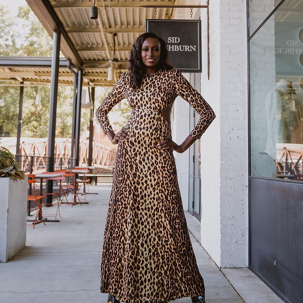Beautiful black lady wearing an animal-print dress