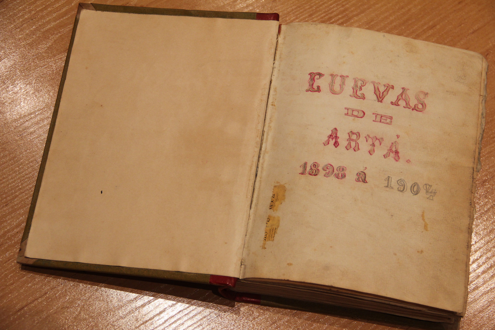 """Volume of the Caves of Artà visitors' book corresponding to the period when they were visited by the expeditioners on the """"San Miguel"""" (courtesy of the Caves of Artà)."""