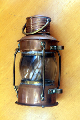 Old ship's copper lantern with visibility on the whole horizon (Jaume Ferrando Collection. Photo by Sebastià Vidal).