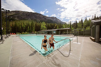 Man and woman stepping out of hot pool.
