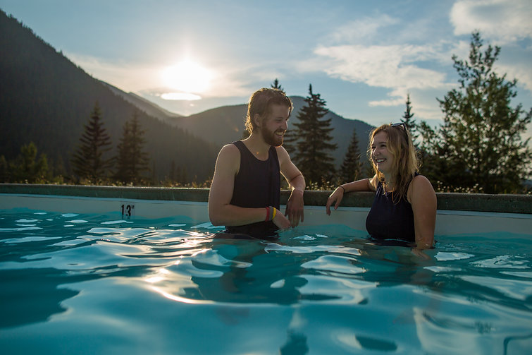 Man and Woman soaking in Miette Hot Springs