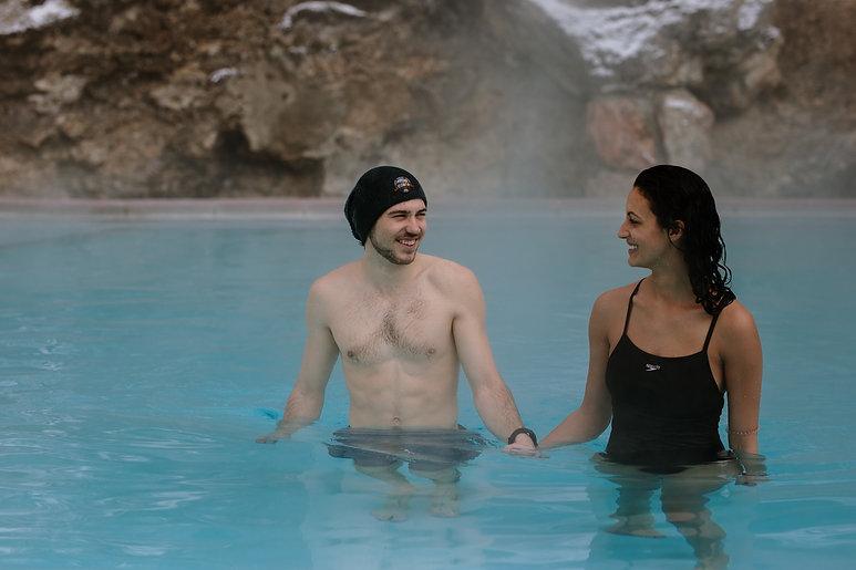 Man and woman soaking in Radium Hot Springs