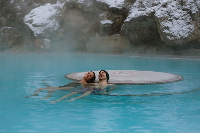 man and women in hot pool