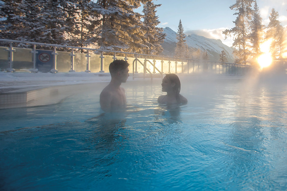 Man and woman in Banff Upper Hot Springs during the winter