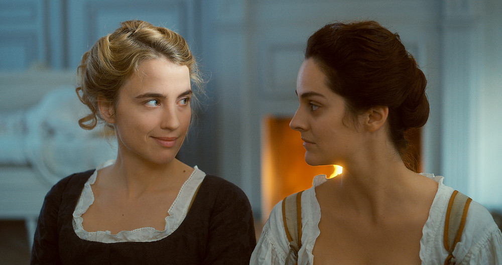 Adele Haenel and Noemie Merlant in Celine Sciamma's Portrait of a Lady on Fire
