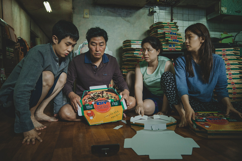 Choi Woo Sik, Song Kang Ho, Jang Hye Jin and Park So Dam in Bong Joon Ho's Parasite