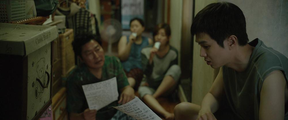 Song Kang Ho, Jang Hye Jin, Park So Dam and Choi Woo Sik in Bong Joon Ho's Parasite