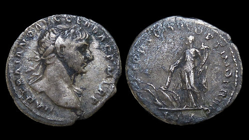 TRAJAN . AD 98-117 . AR Denarius . Goddess Pax burning a pile of weapons