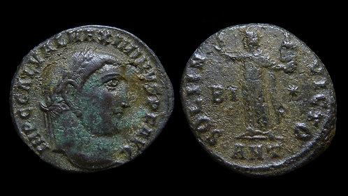 """MAXIMINUS II DAIA . AD 310-313 . Follis . """"Sol holding head of Serapis"""""""