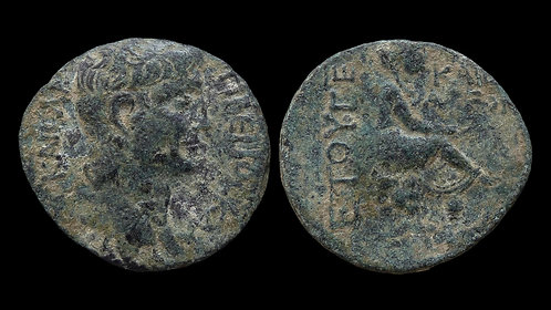 CLAUDIUS . CILICIA, Caesarea . AE25 . Tyche sitting on rocks