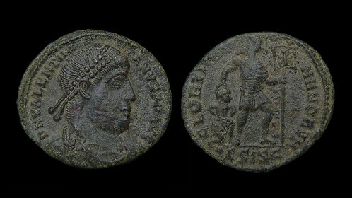 VALENTINIAN I . AD 364-375 . AE3 . Emperor with standard dragging captive