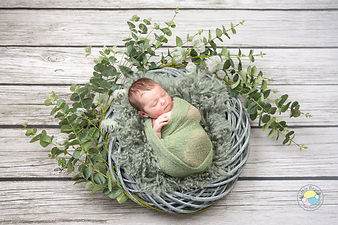 Baby in one of our signature floral rings. We never use digital backdrops.
