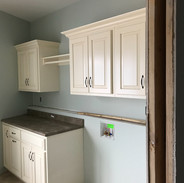 (3) Laundry room cabinets