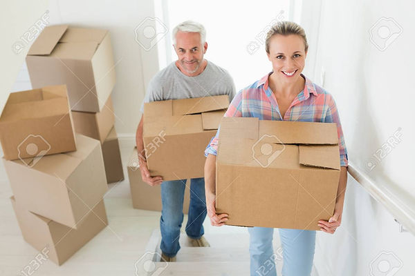 27202246-happy-couple-carrying-cardboard-moving-boxes-in-their.jpg