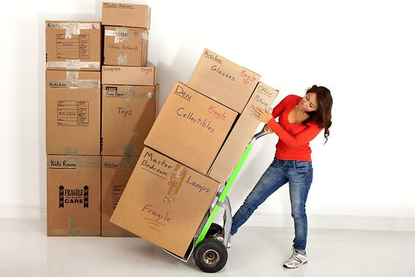 51226188_xxl-Young-woman-moving-a-stack-of-boxes-with-a-hand-c.jpg