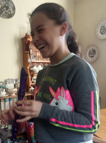 child laughing with a recorder