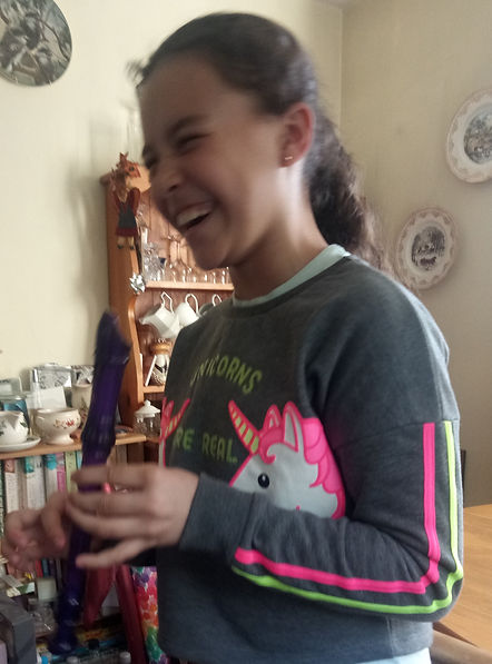 child laughing holding a recorder