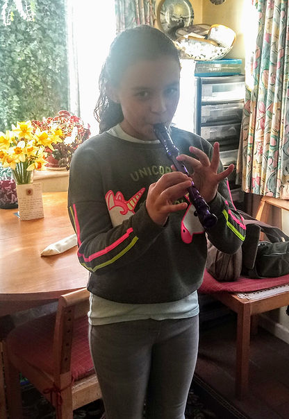 child playing recorder smiling