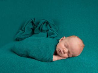 simply wrapped newborn
