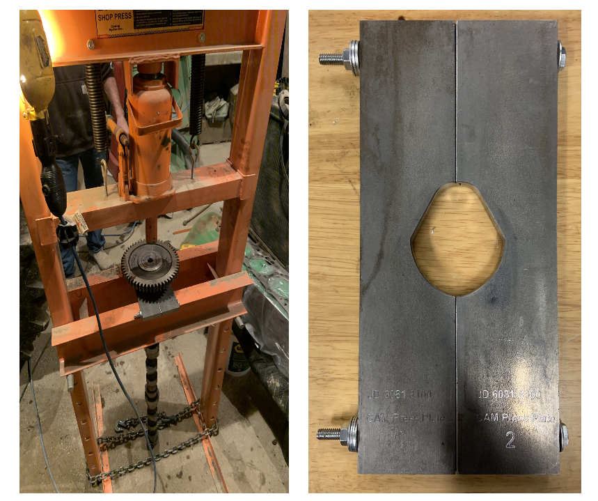 Cam in press while being supported by our shop-built press plate on the left. Press plate by itself on the right.
