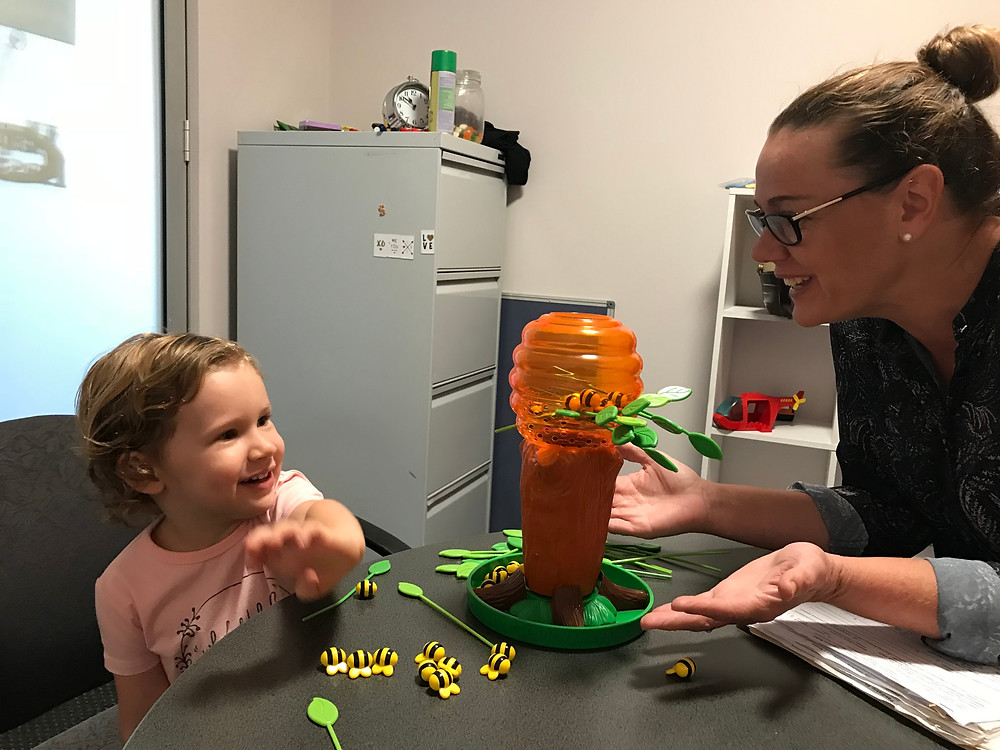 Child smiling during stuttering therapy session