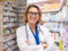 happy-smiling-pharmacist-in-drugstore-C9