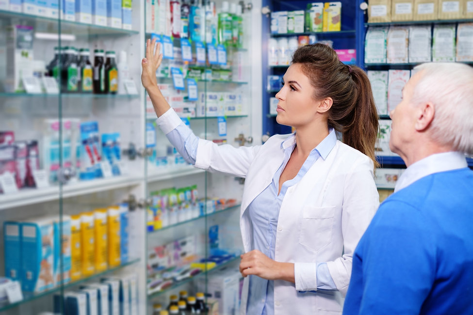 beautiful-young-woman-pharmacist-showing