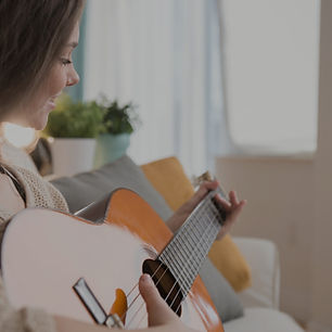 Girl Playing Guitar_edited.jpg