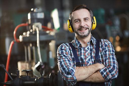 Smiling-worker-wearing-earmuffs-553898.j