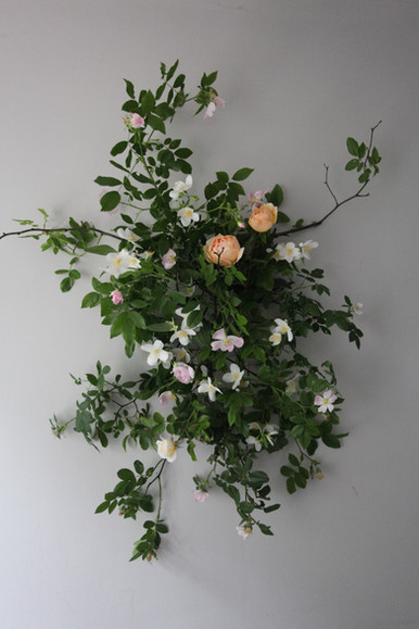 Wild flower wall hangings to welcome guests to an event.