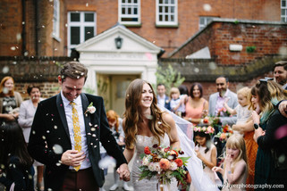 A beautiful September wedding with a bouquet of apricot blooms.