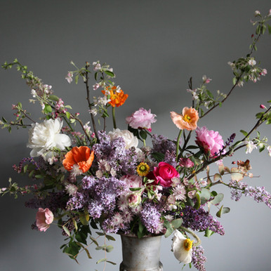 One of our vintage urns filled with scented english lilac, peonies and poppies.