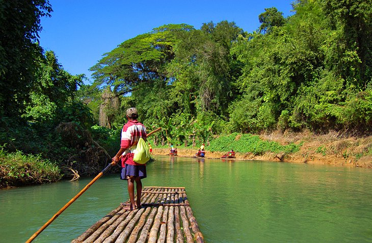 The Martha Brae River has been home to Jamaica's top rafting attraction for decades. The river head is said to shoot from a small hamlet called Windsor, deep within the rocky Cockpit Country, and pours down to the serene setting.