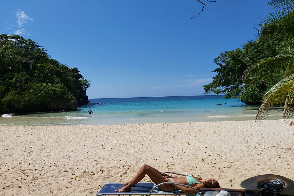 What makes Frenchman's Cove so appealing is the quiet stream that converges into the turquoise ocean. The pristine sandy beach feels exotic next to the calm, bath-water-temperature lagoon. It is a quieter beach scene than other locations in Jamaica, which is exactly why it is popular with those who know about it.
