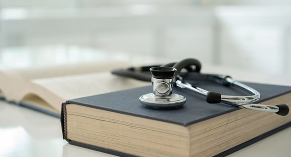 stethoscope on medical guide book for doctor learning treatment at hospital.  medical educ