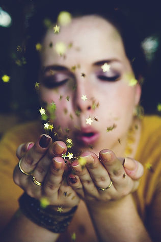 Lady blowing gold glitter.  Sarah Bryer Photo Show / Girl Confidence Life and Career Coaching