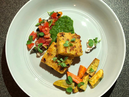 Crispy Polenta with Roasted Vegetables and chimichurri sauce