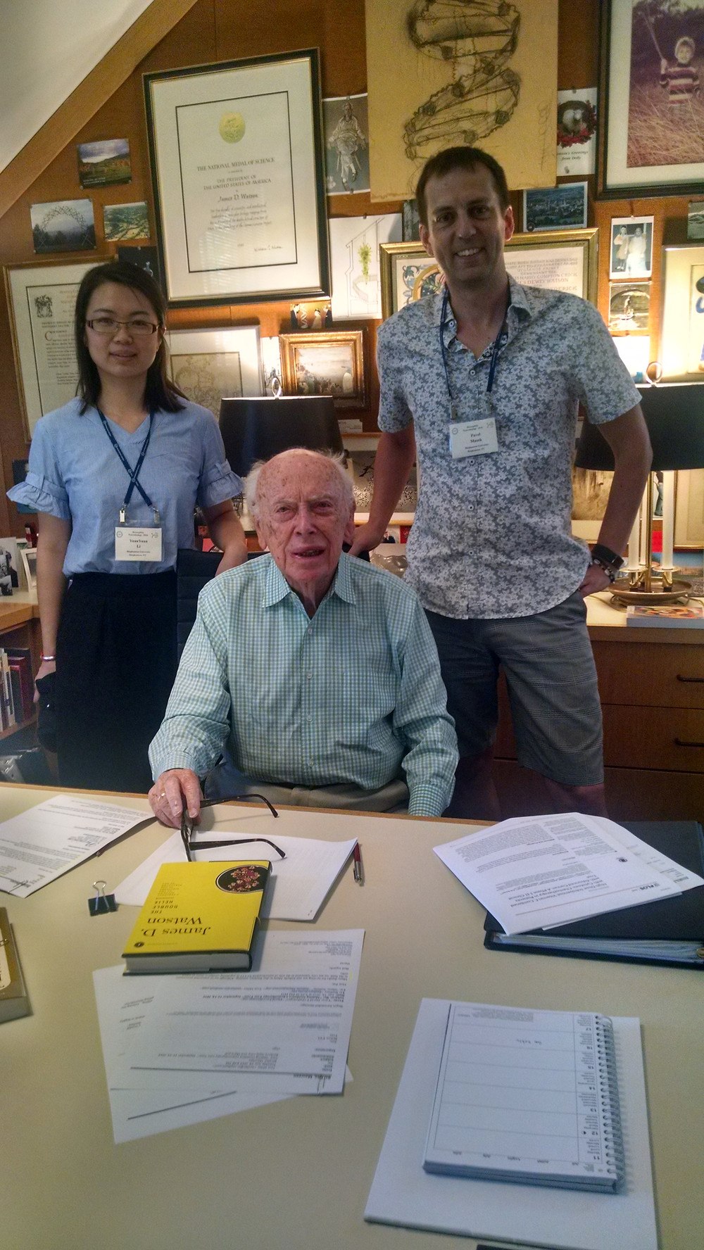 After teaching the Drosophila Neuro course for four years and meeting James Watson in the hallway, I finally found the right time, took Yuanyuana with me, and went to get couple of books signed from him. He is pretty chatty :) Unfortunatelly, I'm covering the framed Nobel Price.