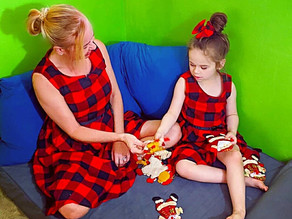 🎄 We tried on our mommy and me Christmas dresses and unwrapped some ornaments!
