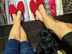 Lounging in our matching pantoffel  house slippers gifted all the way from Germany. 🇩🇪