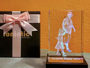 This personalized 3D laser engraved  photo cube from the roniatic store on amazon is amazing!