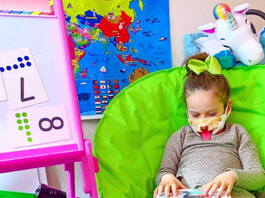 🐶 Zelah loves to wear her doggy mask when reading her new favorite book!