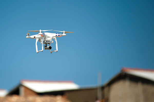 An unmanned aircraft system, or drone, in flight